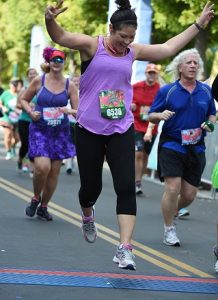 Crossing the finish line at the Disney Tinkerbell Half Marathon in May 2016.